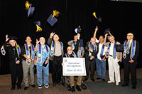 graduates throw hats into the air