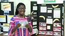 video screen capture of student with her project